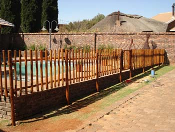 Jungle_Gyms_For_africa_Wooden_Pool_fencing